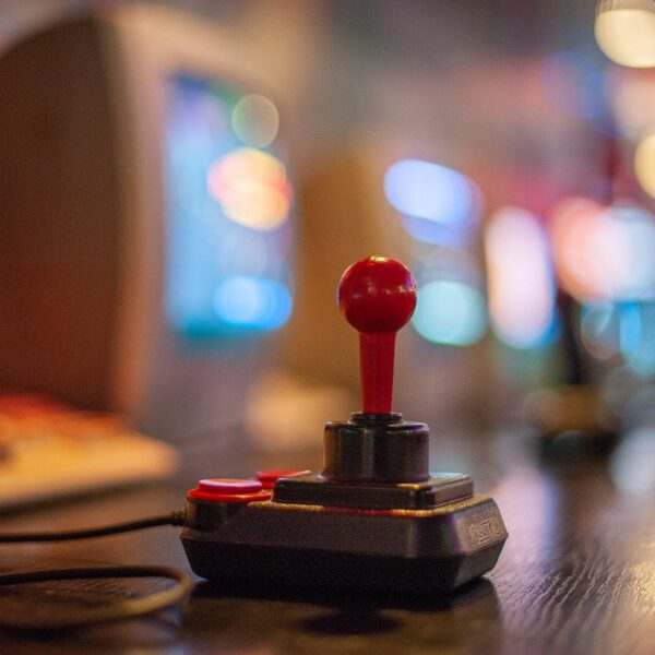 Joystick in front of old computer
